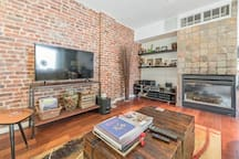 Living room 2 - guest appearances by TV and Fireplace