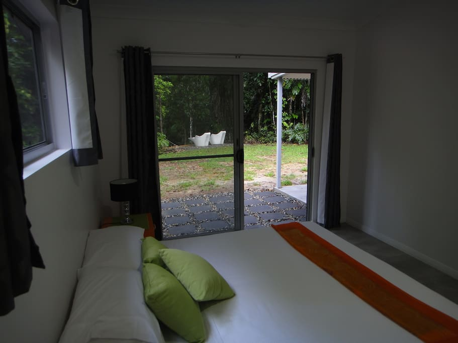 Main bedroom with king bed and outside access