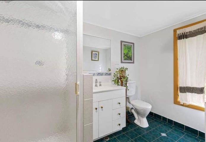 Shared bathroom unless booking entire guest suite. Please contact for a discounted rate if you wish to book the entire floor with all 3 bedrooms.
