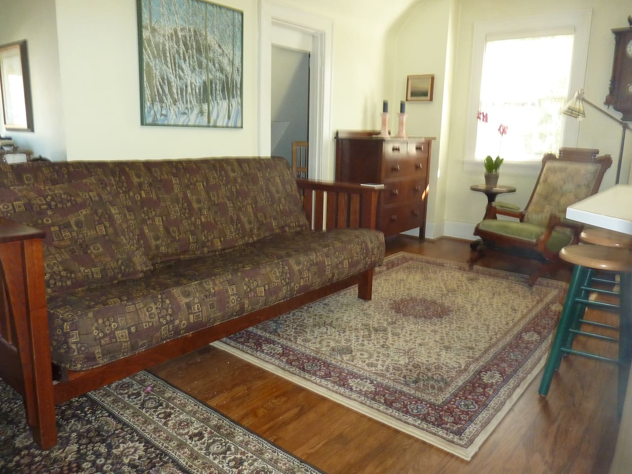 Looking north east from the entry way, with the futon made into a couch