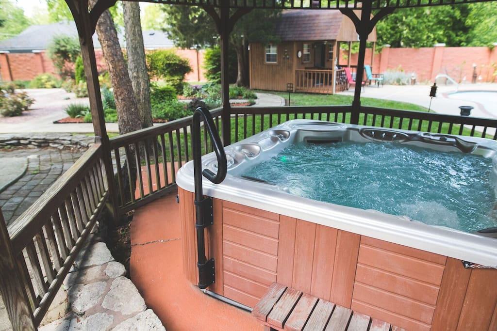 Hot tub under gazebo.