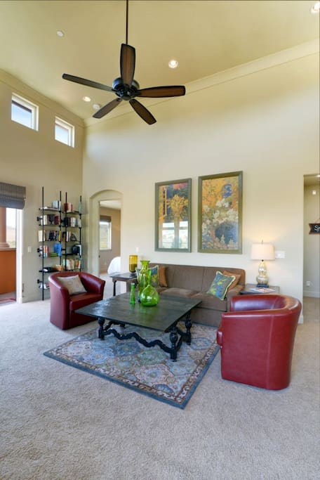 A large open layout. Living room features flat screen tv and a queen sized sleeper sofa.