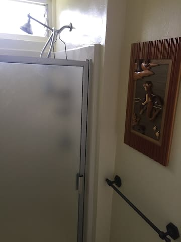Full bathroom with stand up shower.