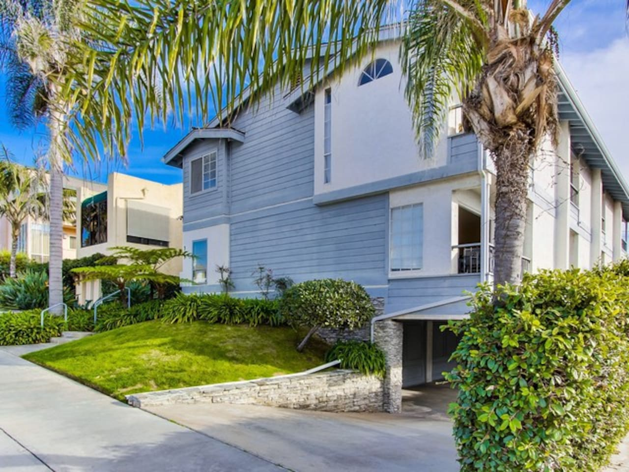 Bonair Beach House is the rear unit that has the garage and then the ground floor has the living area and 2nd floor has 2 bedrooms and 2 full bathrooms.