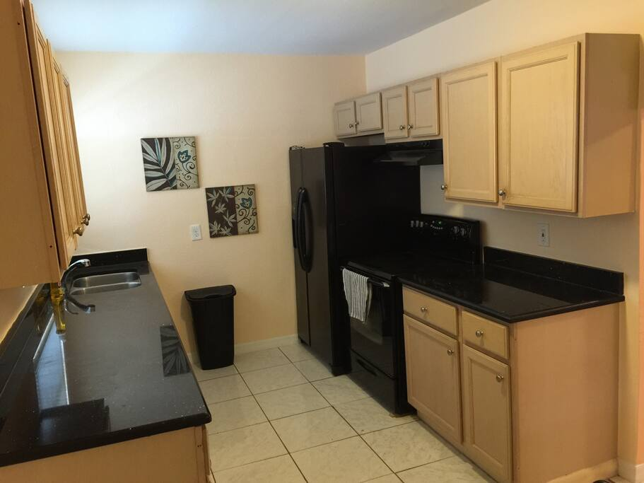 Full kitchen with refrigerator and oven! Everything you need to prepare meals!