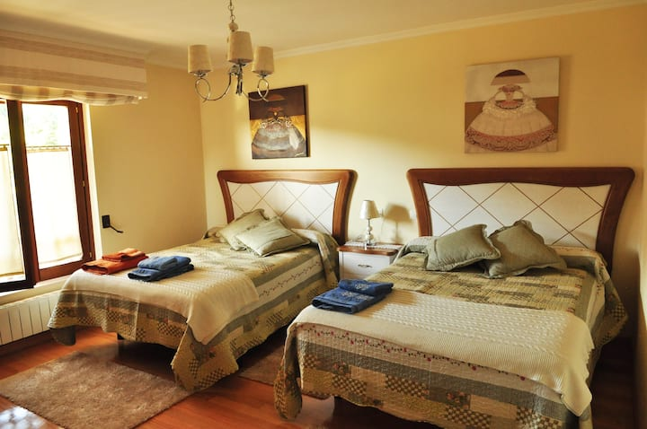 cozy room with two matrimonial bed.
