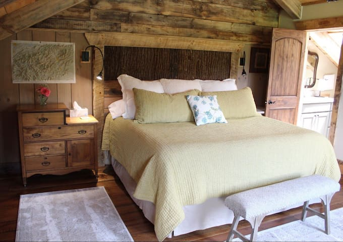 You have a new Sterns and Foster king bed with new linens to sleep on!  Tim created the headboard out of Poplar Bark.