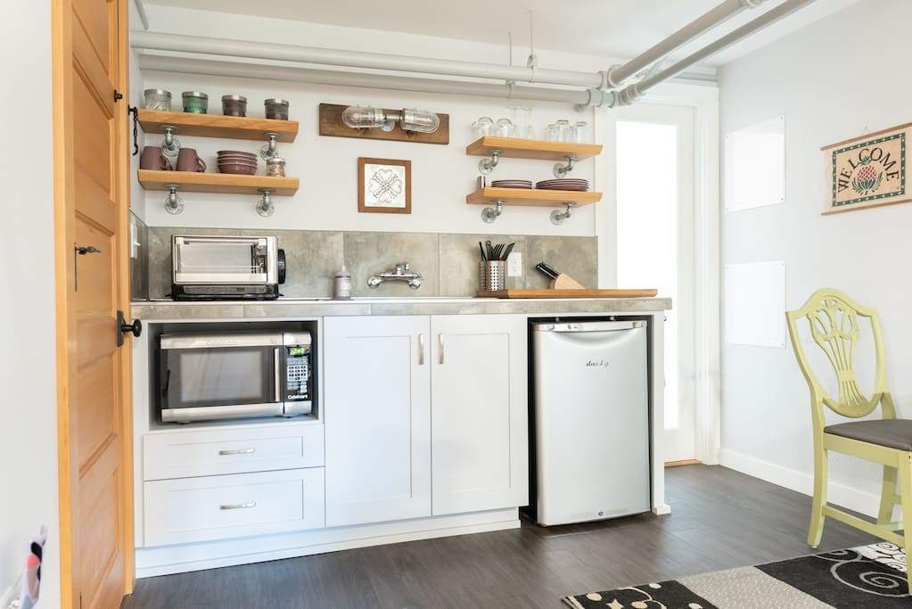 Kitchenette with sink, fridge, micro, toaster oven, coffee maker, etc.