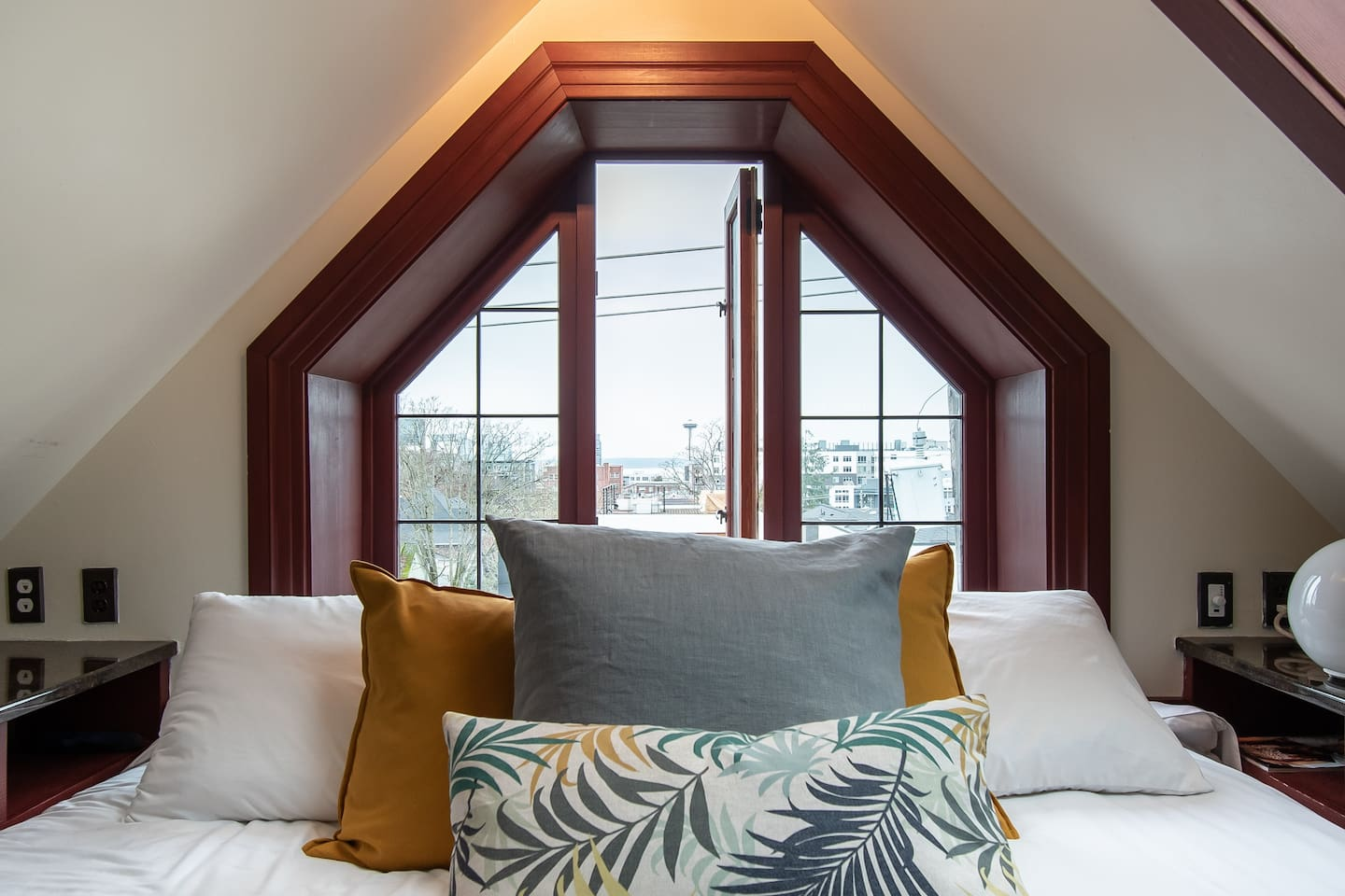 Enjoy the Space Needle views as you snuggle up in our huge comfy king sized bed, with plenty of fluffy pillows and outlets to charge all of your things :)
