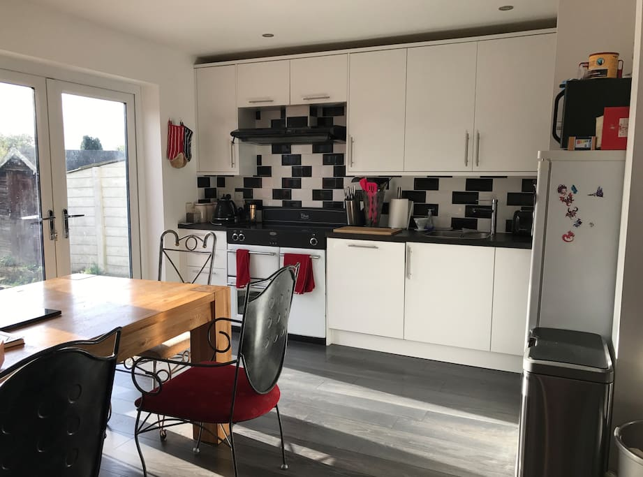 Our lovely kitchen with its optical illusion tiles that look all wonky but aren't it's hard to get the right angle for it, this is the wonkiest I've been able to make them look! Hob is digital induction, layout is very logical, bin is also electric so you just wave your hand over it and it opens.