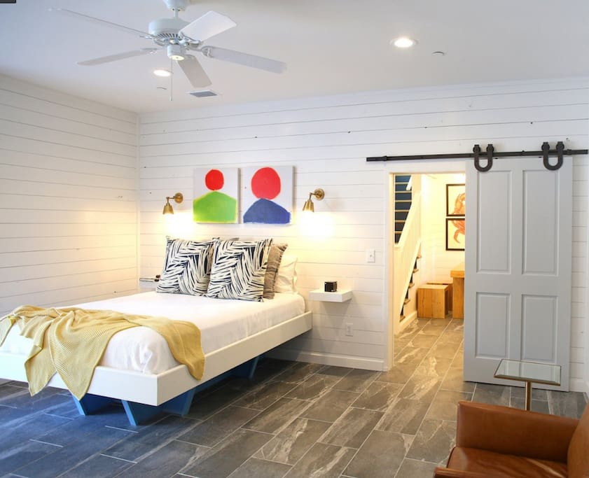 Spacious and cozy downstairs with signature floating queen beds