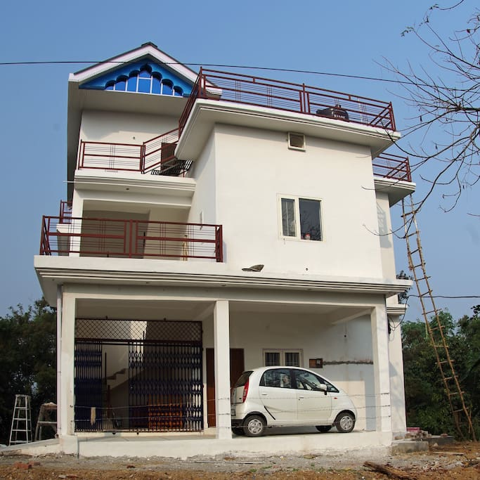 Front view. Independent 1100 sq ft guest accommodation on the first floor. Two patios. Front patio, visible in the photo, is huge! Guests have access to the rooftop which has an exhilarating picture-postcard like view of river Beas flowing into Pong reservoir.
