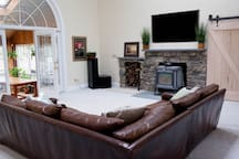 Family room, awesome whole house sound system, wood burning stove, huge smart tv, giant couch can be used to sleep on.