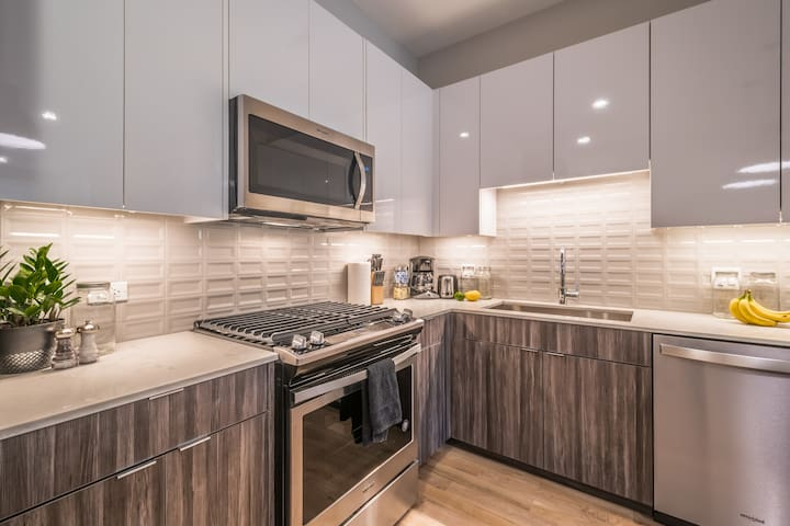 Imagine entertaining in your upscale, designer kitchen!  Open a bottle from the wine fridge and let the conversations flow through the open floor plan!
