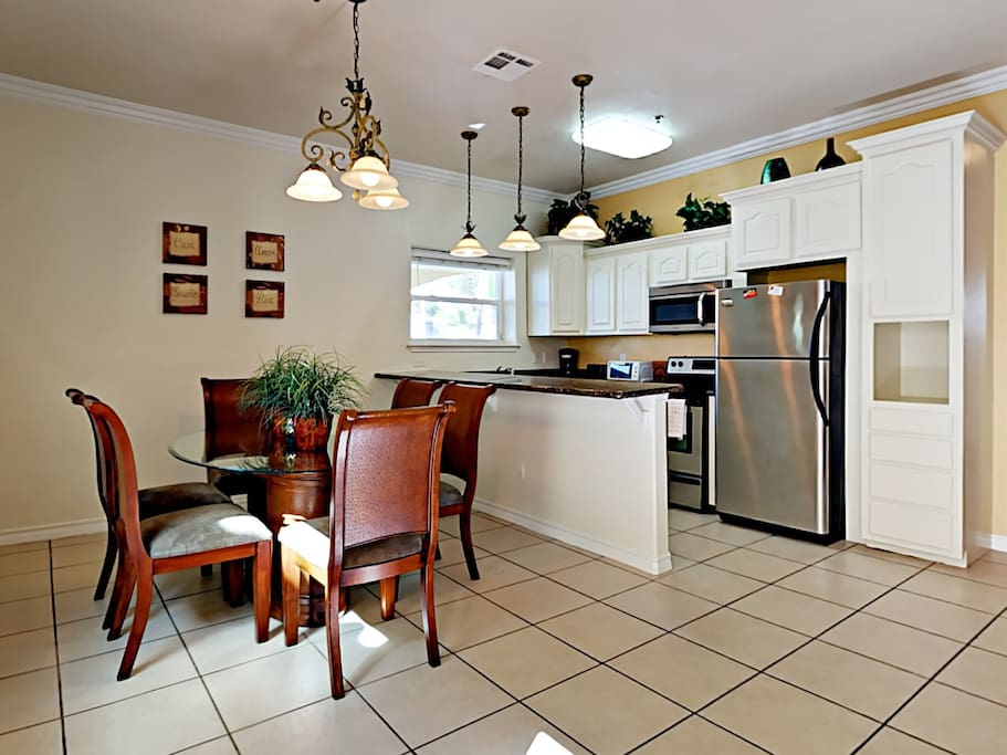 Encouraging conversation, the kitchen and dining area share an open-floor concept.