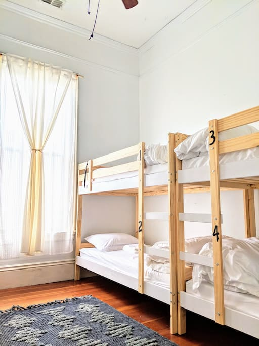 This large room has everything you need for a super comfy stay! Memory foam mattresses, towels, free slippers, ear plugs, lights beside each bed, outlets and USB plugs beside each bed, lockers with locks included, and more. :)