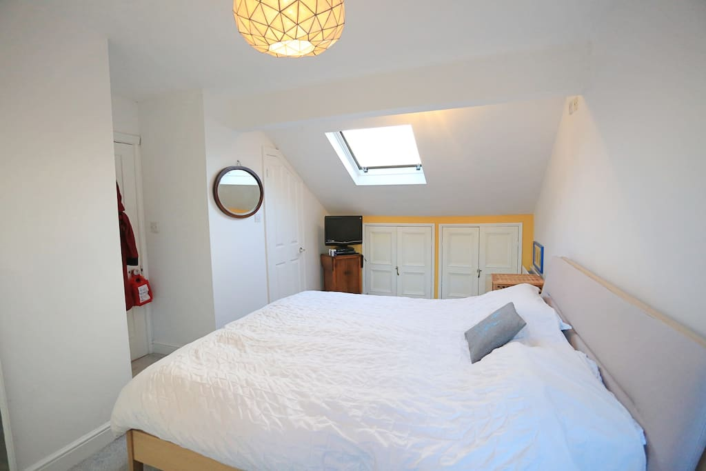 Loft bedroom with super kingsized and en suite bathroom. Plenty of room for a child's travel cot.
