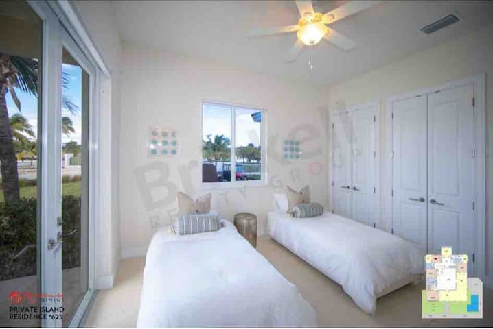 The fourth bedroom also resides on the right-wing, furnished with two twin beds and plenty of closet space