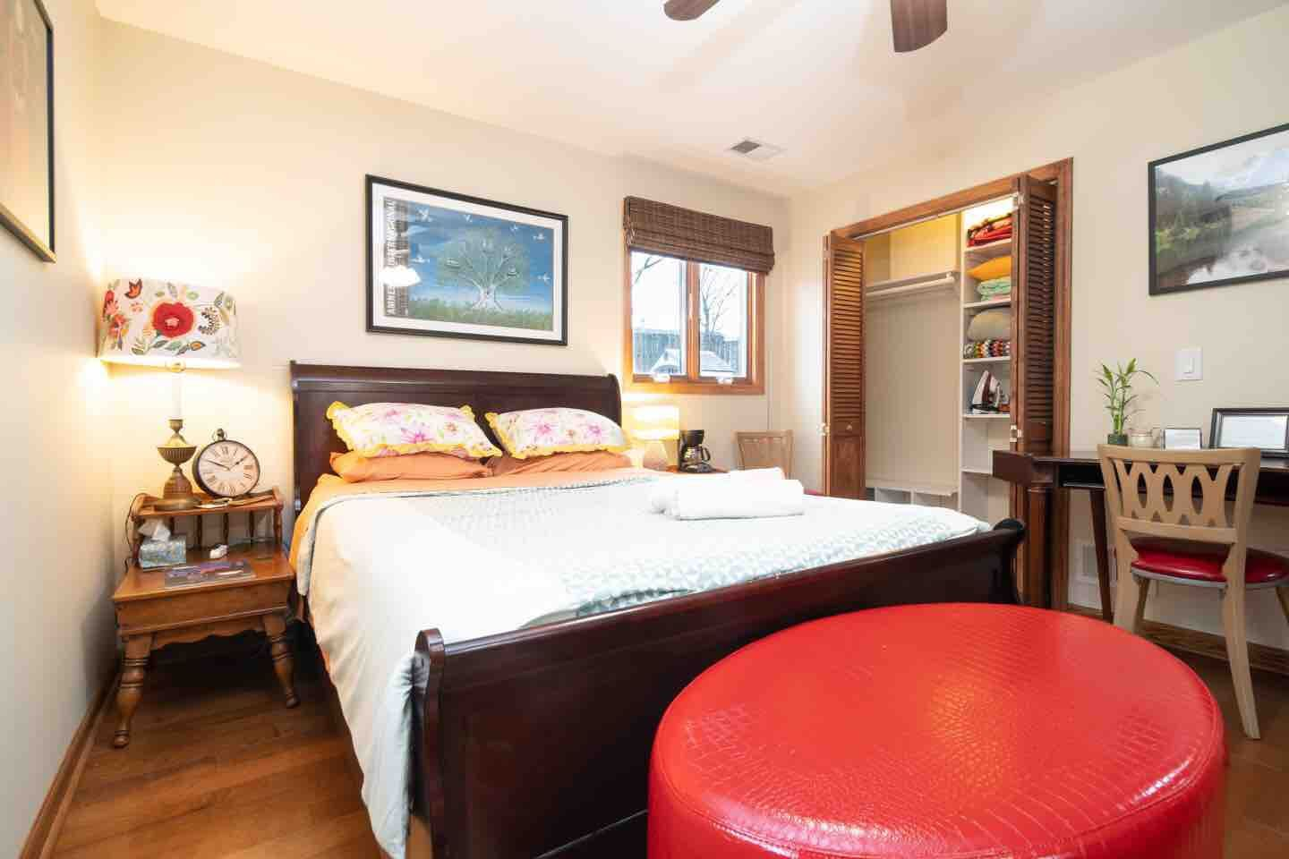 Bohemian oasis is right here! Queen size bed, small desk, coffee pot, cool artwork, bold colors