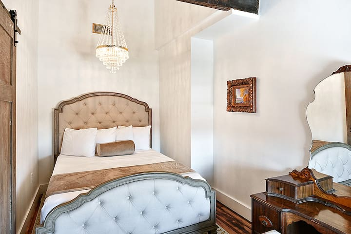 Bedroom #1: cathedral ceiling above the bed, Antique furniture, empire crystal chandelier and tempurpedic mattresses for maximum comfort