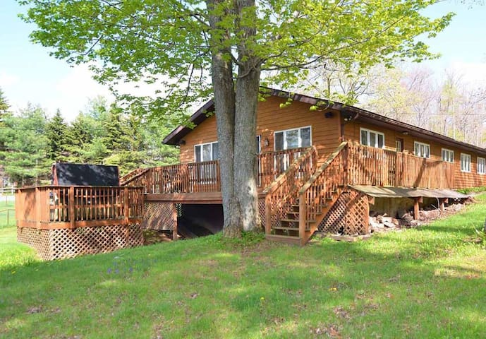 Lake front home with private dock, hot tub, gas grill and fireplace!
