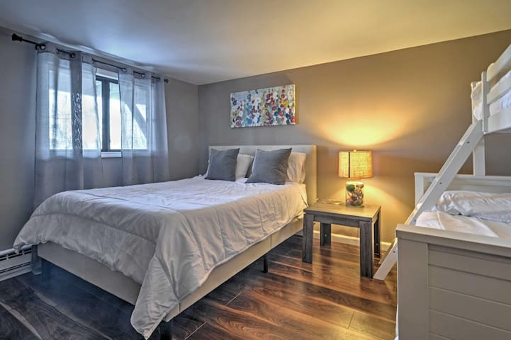 Snuggle up in this Comfortable queen-sized bed and Full over twin bunk bedroom.