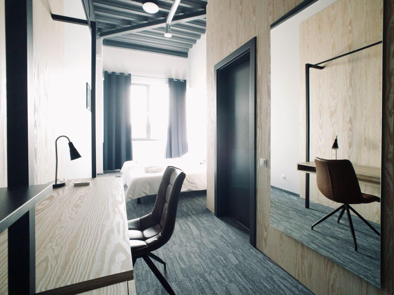 Private room with two single beds, with private restroom.