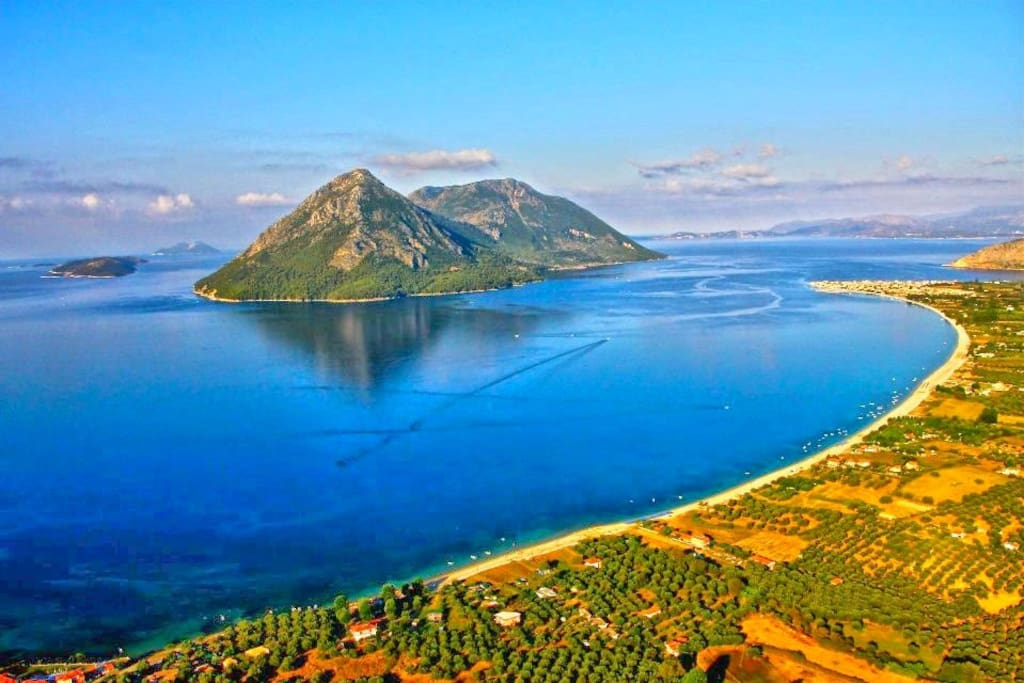 The location and the beach of Paliovarka from above with view of the island's of Kalamos Kastos Ithaka  Kefalonia Lefkada and Meganisi