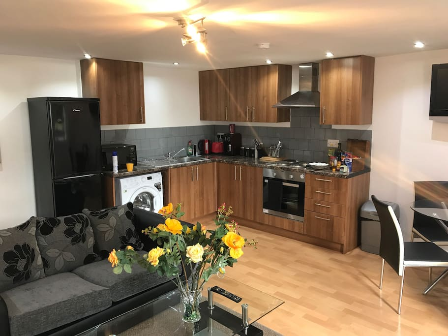 Fully functioning kitchen with electric kettle, coffee maker, toaster, micro-wave oven, fridge & freezer, oven and hob, washing machine, cutlery and other essentials