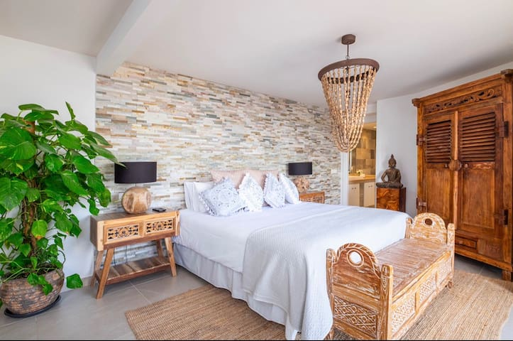Double en suite bedroom overlooking the pool area and the stunning views from Mijas .