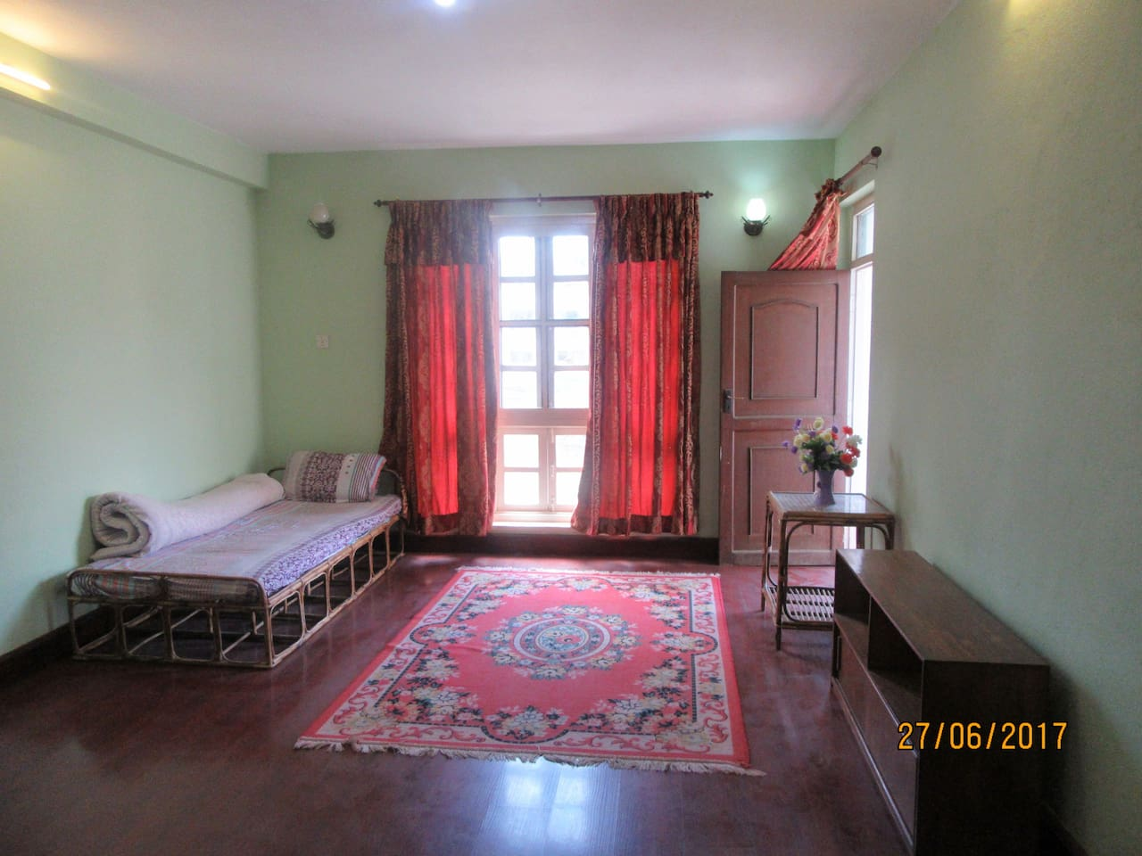 Master Bedroom with balcony, furnished with bed, table and closet. 24 hours free WiFi available.
