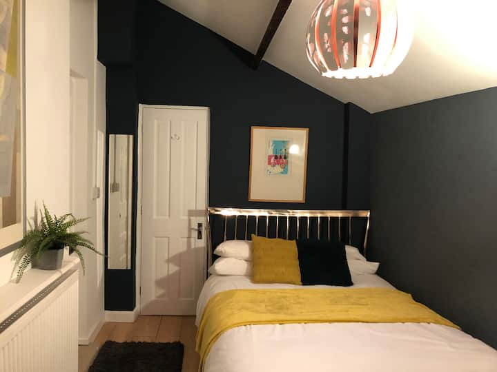 Funky private bedroom with own en suite and entry.