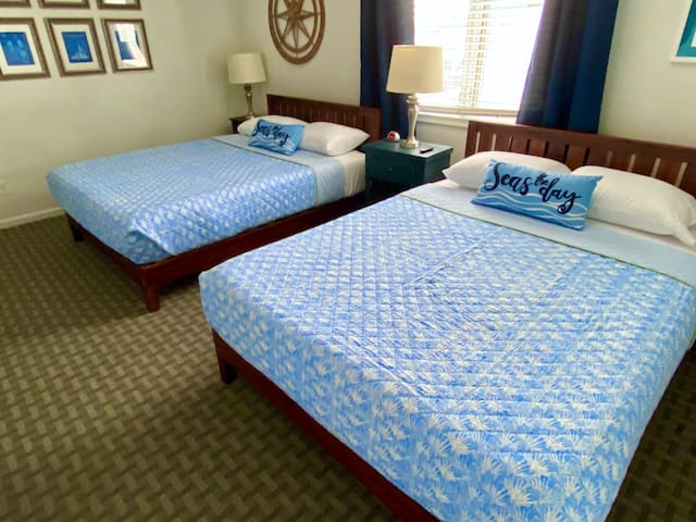 Our spacious second floor suite has two queen beds, a large bathroom and a flat screen TV.
