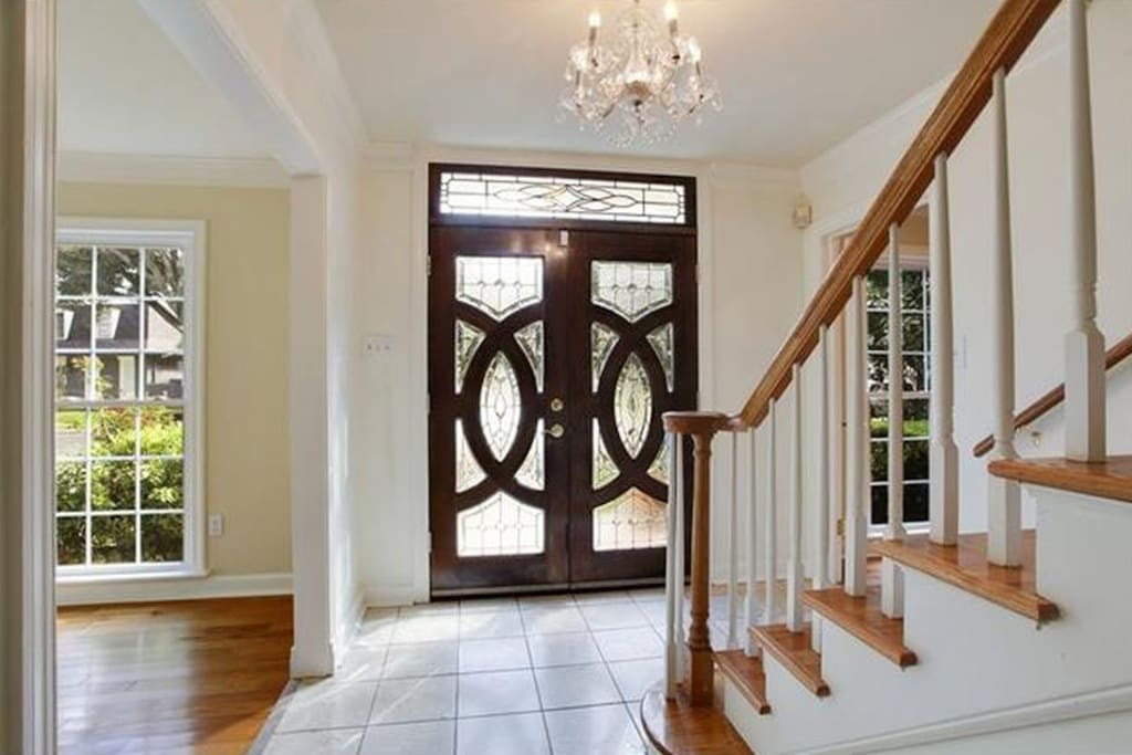 Front door and stairs leading to your room