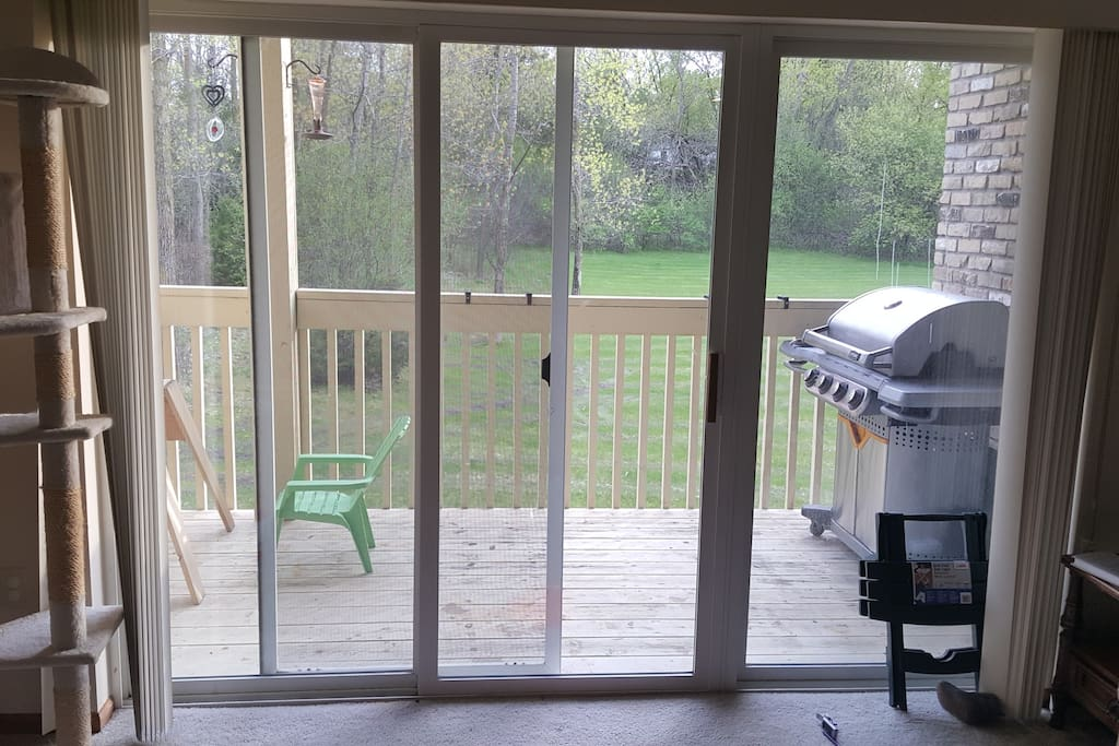 View looking out from living room. Two zero gravity chairs will be on the balcony.  Grill is available for using.