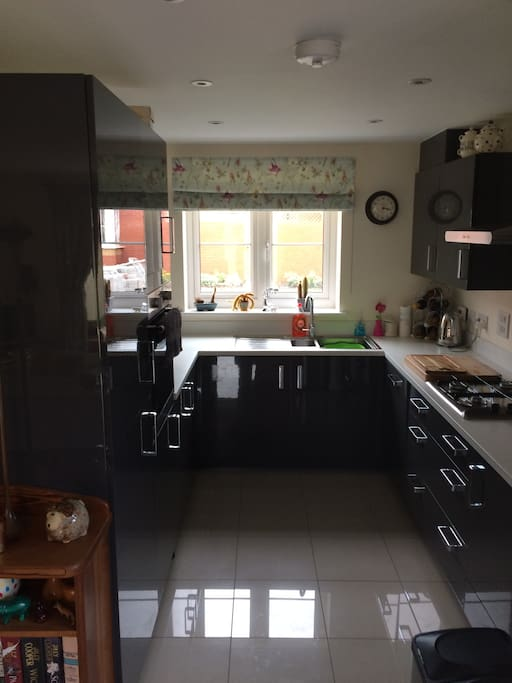 Bright kitchen with lots of workspace, gas hob, oven, microwave & Nespresso machine