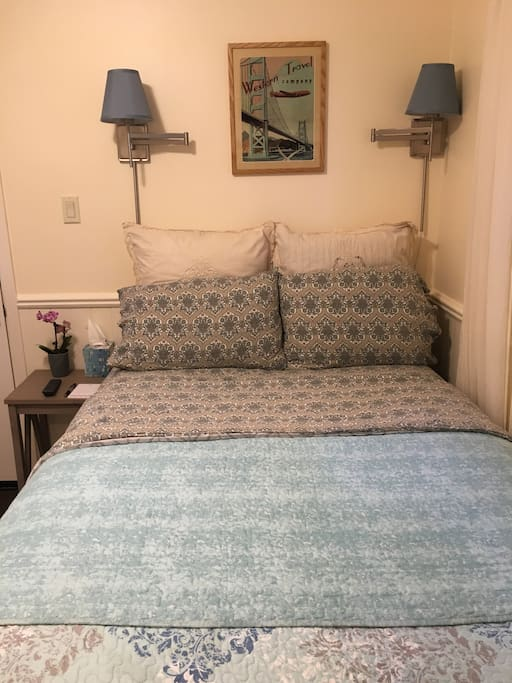 A cozy double bed with an extremely comfortable mattress, your host Tracy.