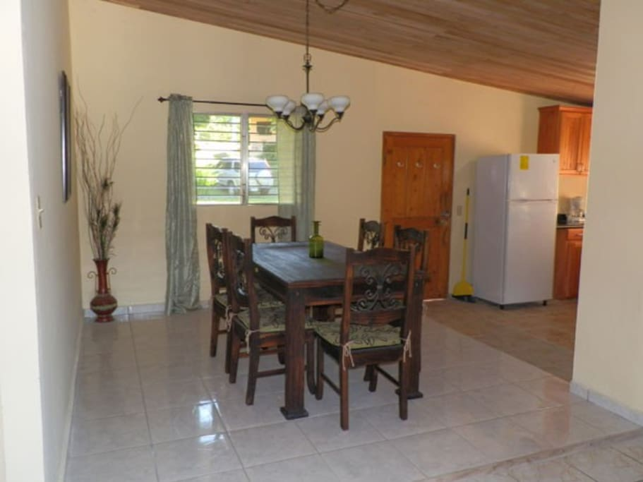 3 Bedroom dining area off kitchen and living room.  Back door access to the back yard.
