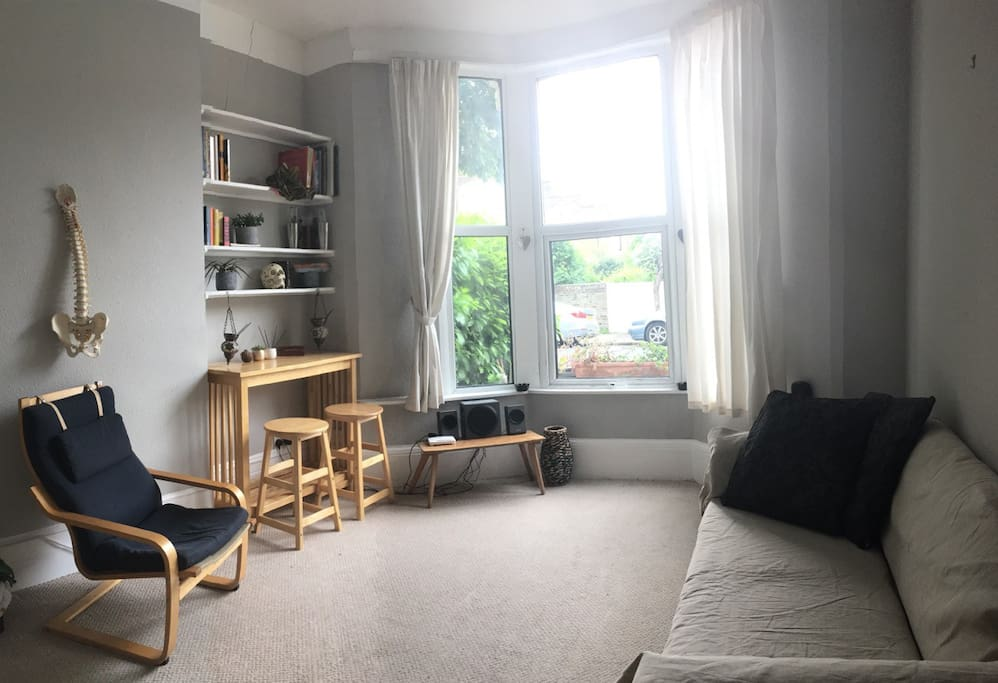 Living room, double sofa bed, sound system,working desk.