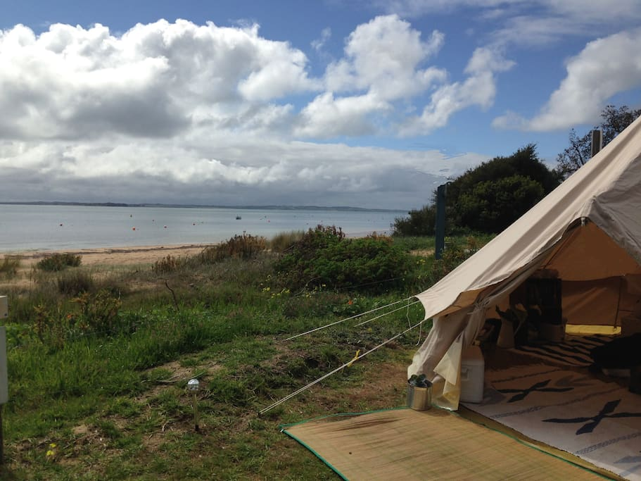 Stumble out of your tent for a swim or a walk on the beach