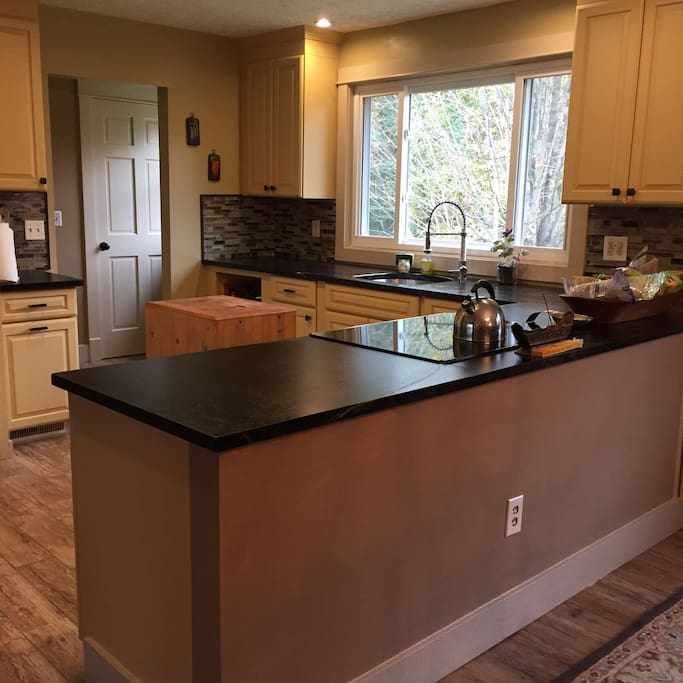 Kitchen with soapstone counters and tile floors