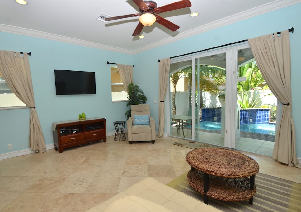 Spacious Open Living Area Overlooks Pool Lounge + Features Leather Sleeper Sofa + Chair + LED HD TV Entertainment Center...