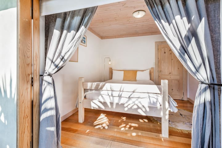 The second Queen sized bedroom also opens onto the balcony.