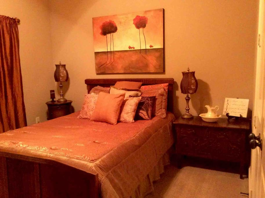 This room is a spacious room with warm hues and black out curtains for awesome sleeping.