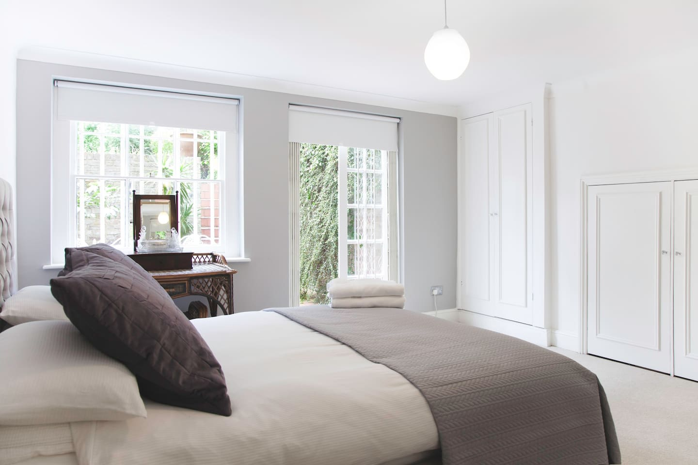 Master bedroom with direct access onto charming patio area