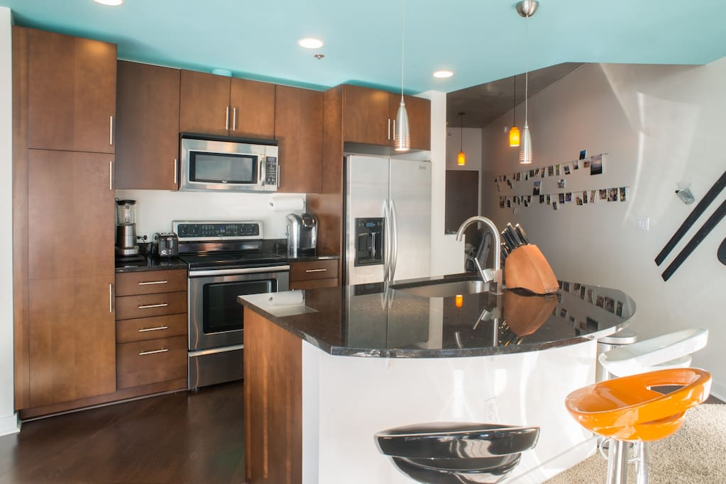 Full, open kitchen with large island.  Stainless steel appliances, Keurig, toaster, blender.