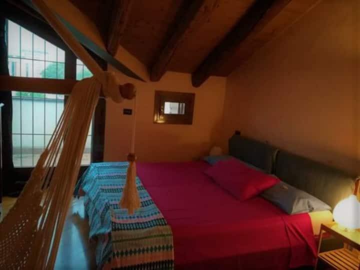 Romantic attic room with jacuzzi bathroom