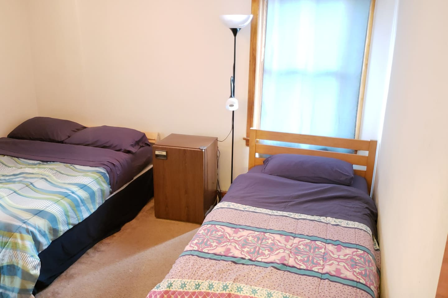 The room contains a full bed and a twin bed.