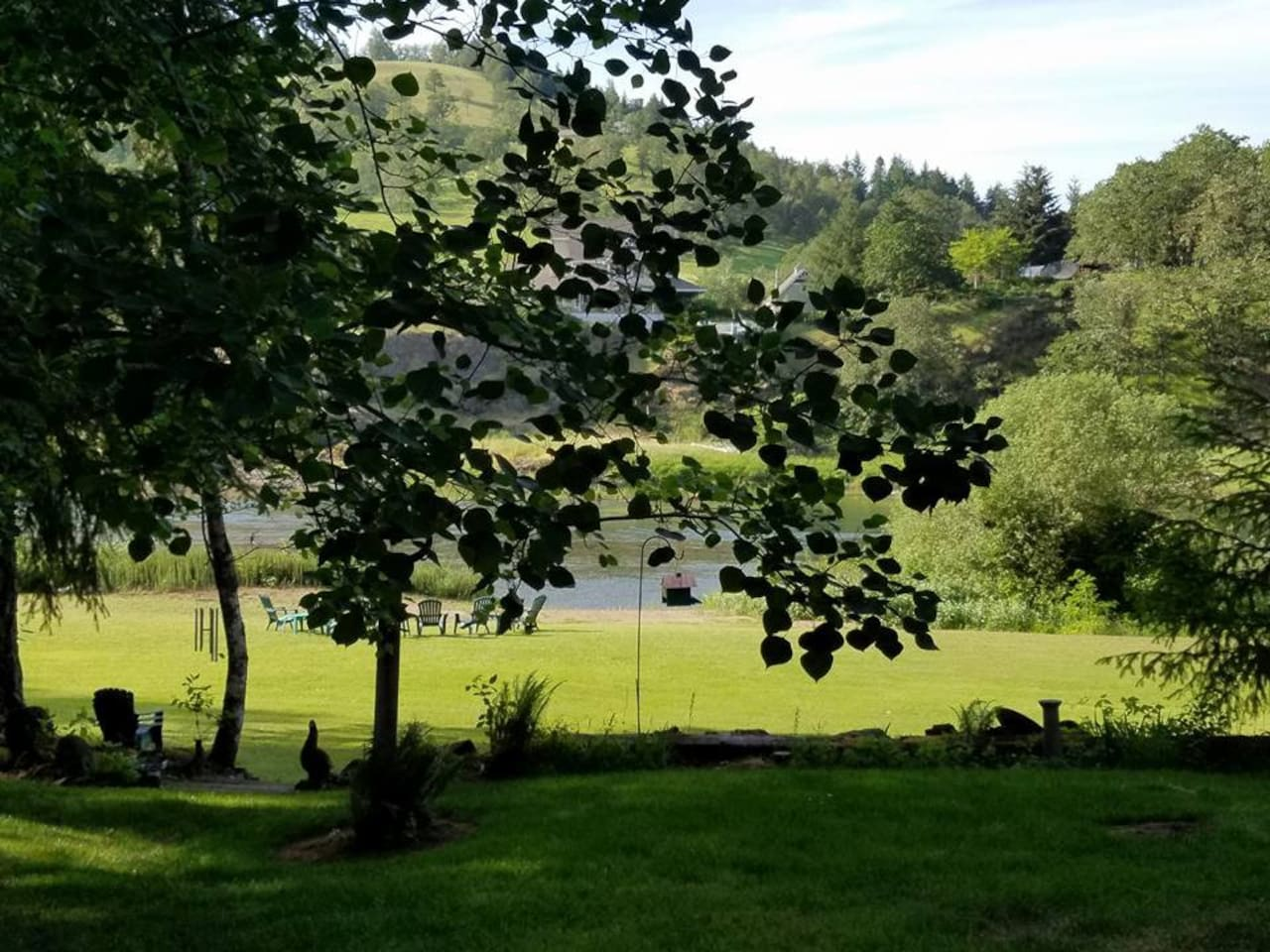 View of our yard & river frontage from our front porch.