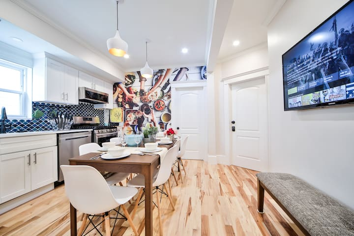 You will love gathering and eat in this space featuring a stunning wall art with Smart Fire TV. Ask Alexa to play Games of Thrones or your favorite show/movies.